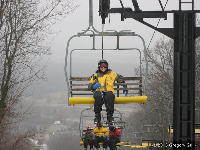 A skier rides a chair lift at Cascade Mountain, Wisconsin