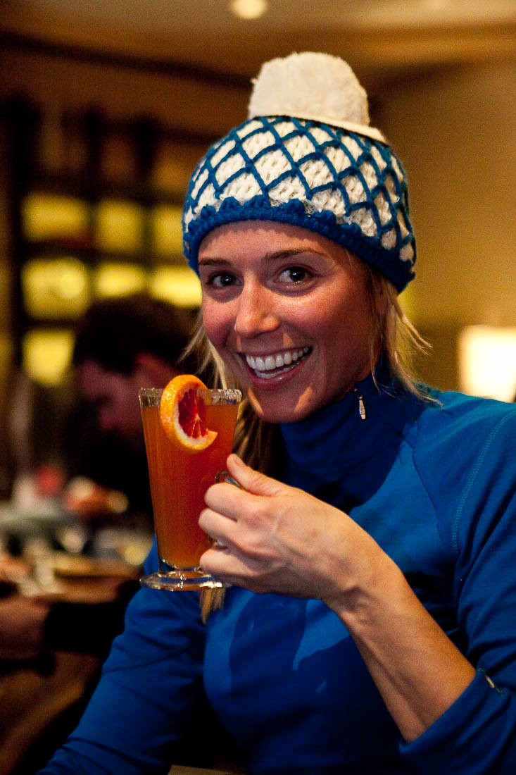 Darcy enjoys a cocktail in the lobby of the Little Nell hotel at the base of Aspen Mountain. Besides the Nell, you'll also find her enjoying après at the Aspen Brewing Company and the Highlands Alehouse. - ©Jeremy Swanson