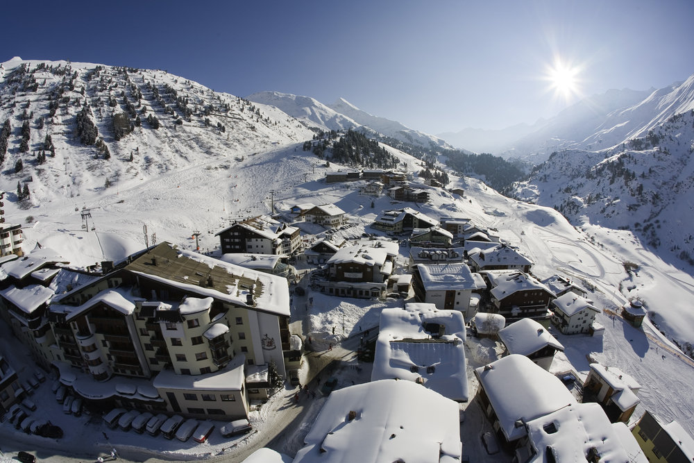 Looking down over a snow-covered Obergurgl village centre - © Obergurgl-Hochgurgl