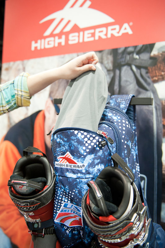 On the scene in Sochi right now, the U.S. Ski Team backpack from High Sierra is fully equipped with boot and helmet holders and a tricot goggle pocket. - ©Ashleigh Miller Photography