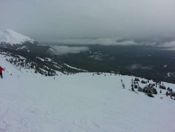 Light snow all day....great conditions all over...no lines! Awesome first time skiing Louise!