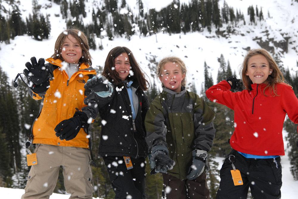 Kids having snowball fight