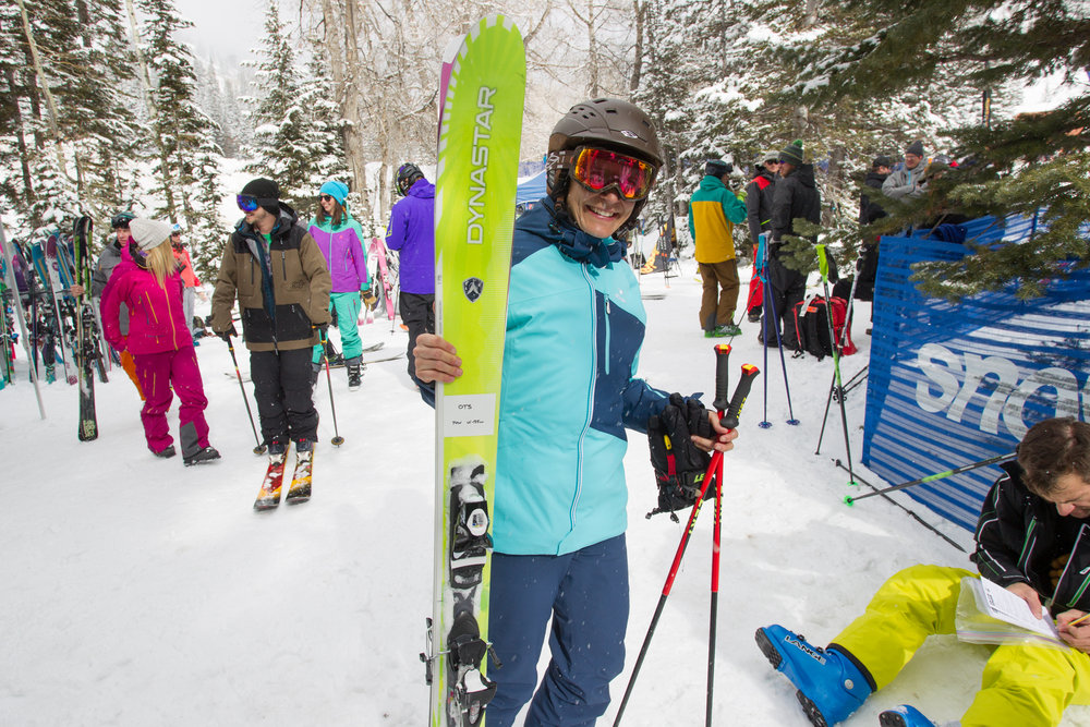 Ali Sibley ready to rock with pow skis in hand. - ©Cody Downard Photography