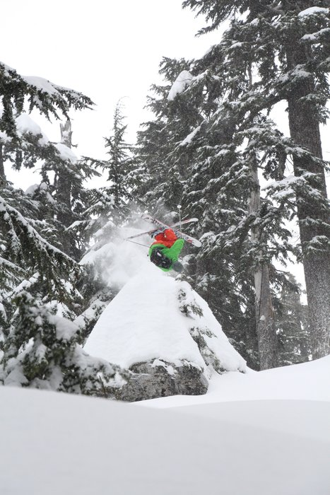 Andy Devore backflips off a snow pillow at Summit at Snoqualmie. - © Karter Riach courtesy of Summit at Snoqualmie
