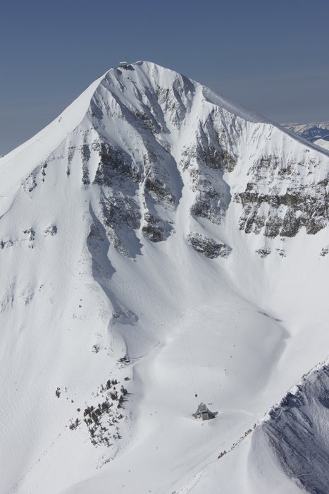 With a 50-degree pitch and more than 1,000-foot vertical drop, Big Sky's signature run, Big Couloir, is no joke. In fact, skiers looking to check it off their bucket list must sign out with ski patrol, have a partner, transceiver, probe and shovel. - © Michel Tallchet