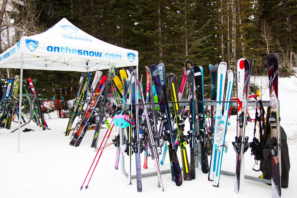 Dozens of pairs of skis awaiting you among the trees... ski testing does not suck. - © Cody Downard Photography
