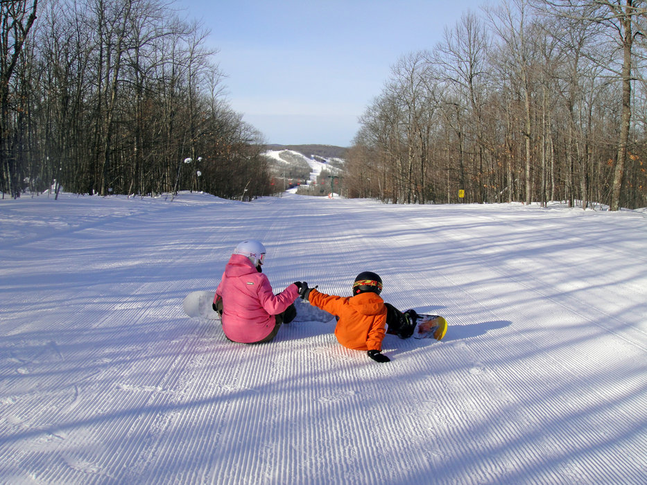 Fist bumpin' on a great day at Indianhead. - ©Indianhead Mountain Resort