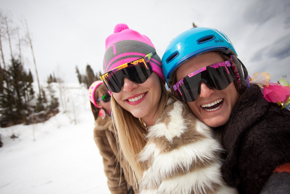 Meredith and Meaghan Lynch, a friend and co-worker in the PR department, rock Pit Vipers during a 'Get the Girls Out' ski day on Aspen Mountain. The event is organized by She Jumps as part of a national campaign to unite women in the outdoor sports world. - ©Jeremy Swanson