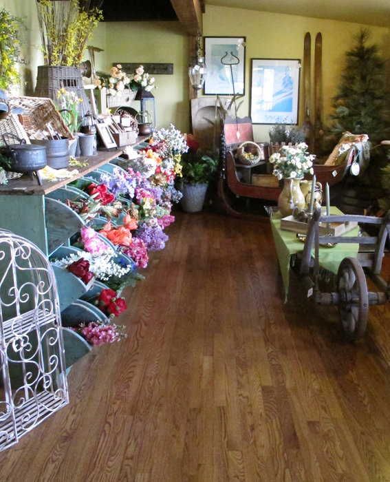 In addition to antiques, Ski Country Antiques & Home sells florals, artwork, lamps, throw blankets, pillows, rugs, candles, body care, scarves and books, to name a few. - ©Heather B. Fried