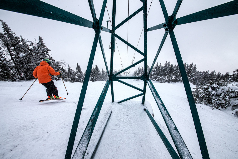 Skier, Carter Snow takes a lap under the renowned MRG single chair. - © Liam Doran