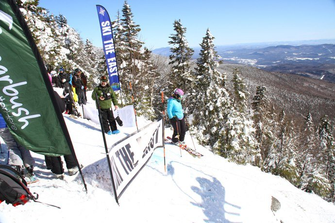 Skiers waits to drop in during the Castlerock Extreme at Sugarbush. - ©Sugarbush