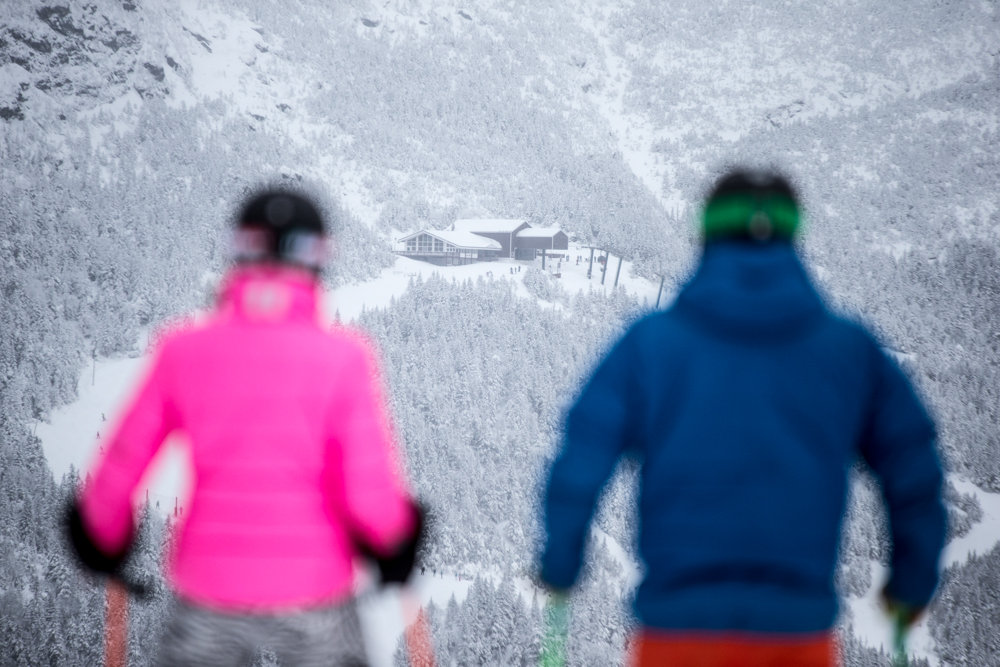 Stowe skiers, Seth and Kristi take in the view of Mt. Mansfield, Vermont's highest. - ©Liam Doran
