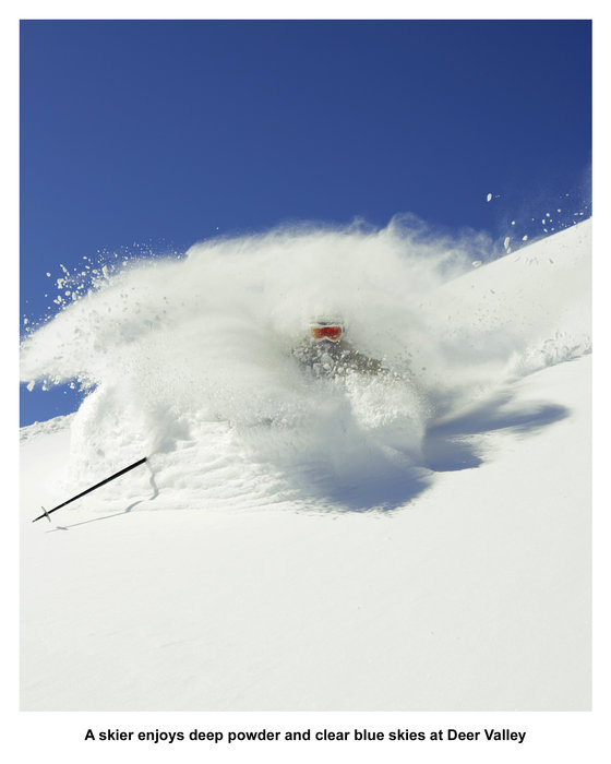 A skier enjoys deep powder and clear blue skies at Deer Valley. - © Skiifo