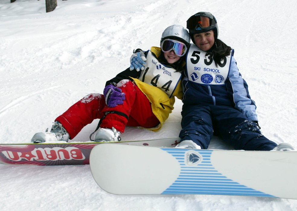 A pair of young snowboard racers resting at Beaver Creek.