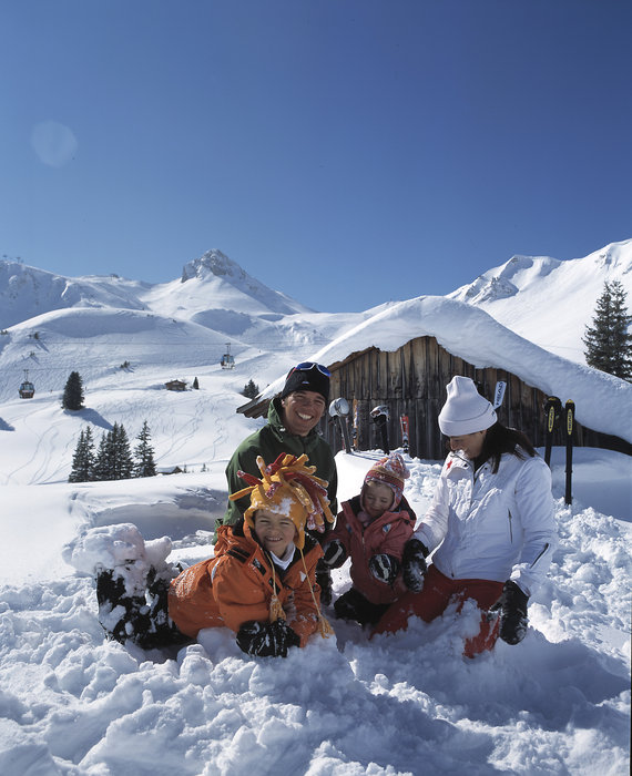 A family playing in the snow at Adelboden.