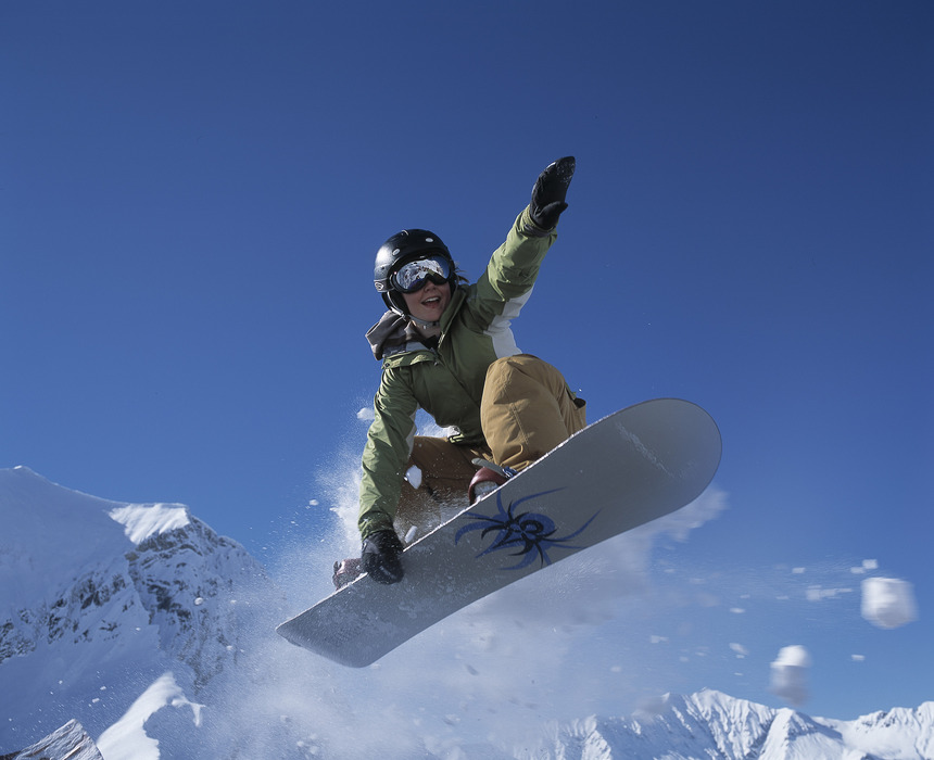 A snowboarder performing a grab at Adelboden.