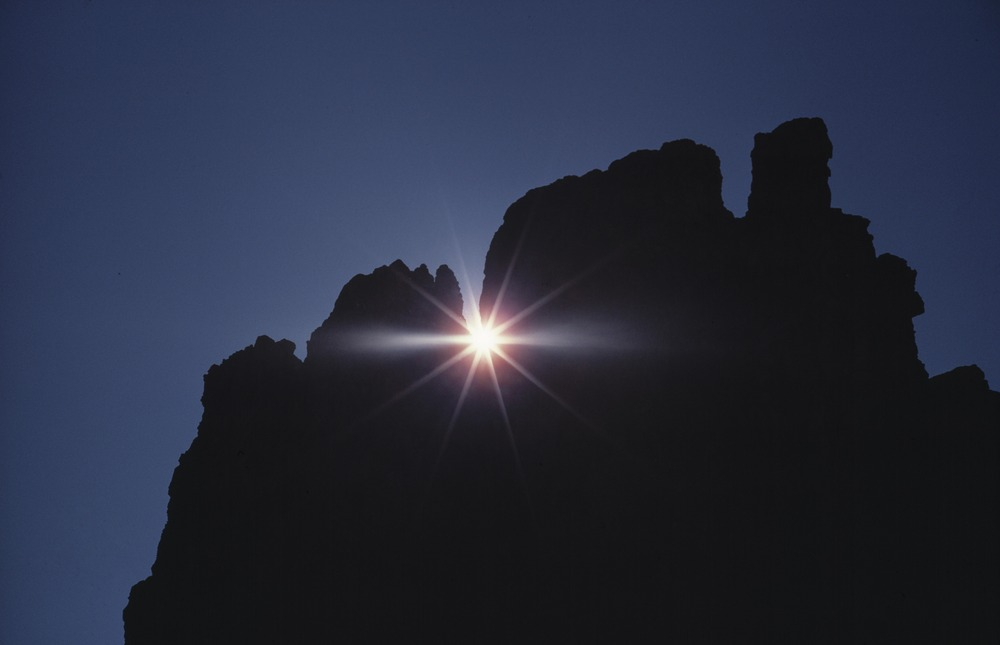 The sun peeking through rocks at Adelboden.