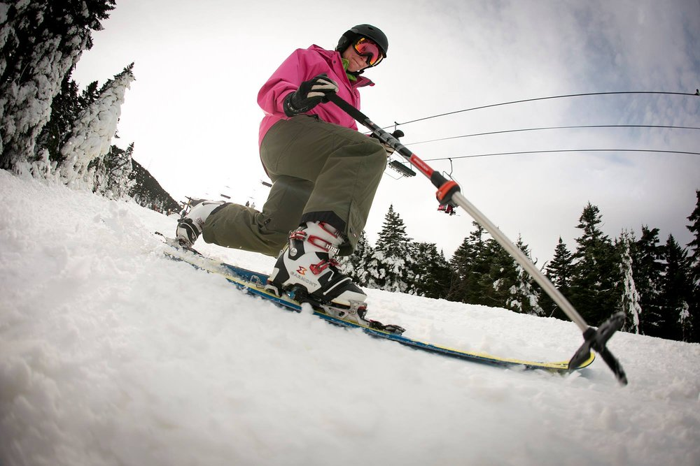 A telemark skier gets her first turns of the season at Killington. - © Killington Resort
