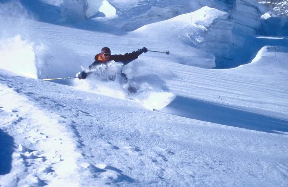 A skier deep in the powder of Saas Fee.
