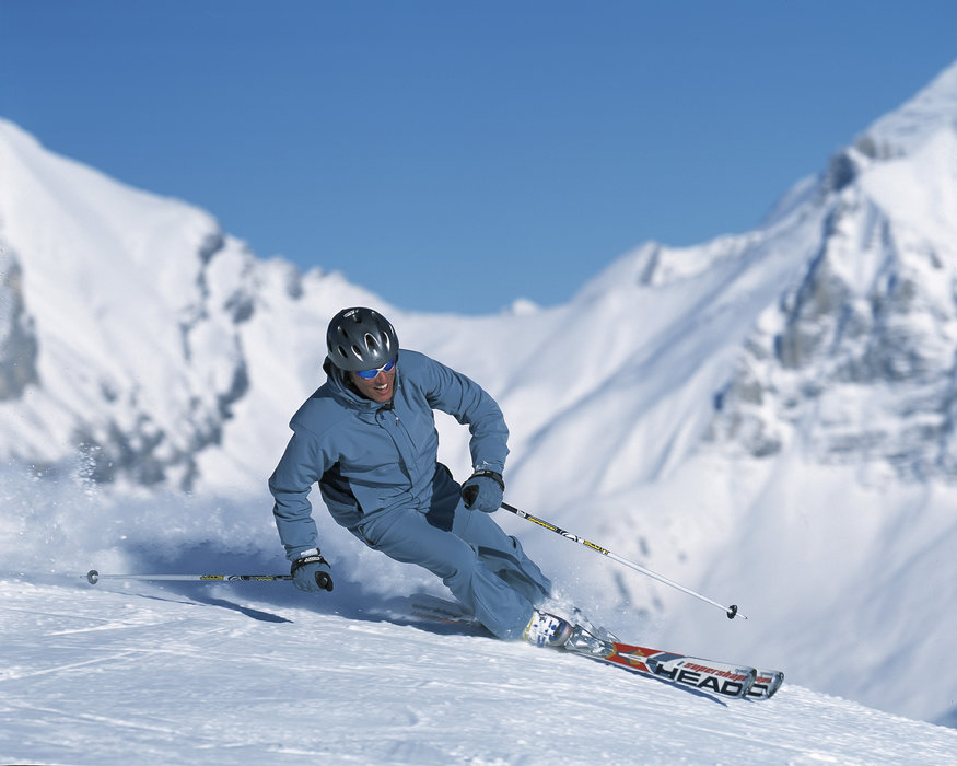 A skier carving a turn at Adelboden.