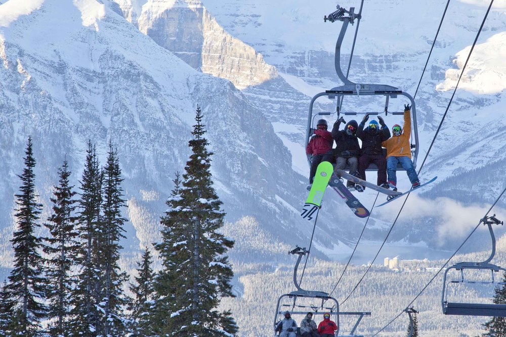 Snowboarders cheer opening day on Nov. 13, 2014 at Lake Louise Ski Area in Banff. - ©Chris Moseley