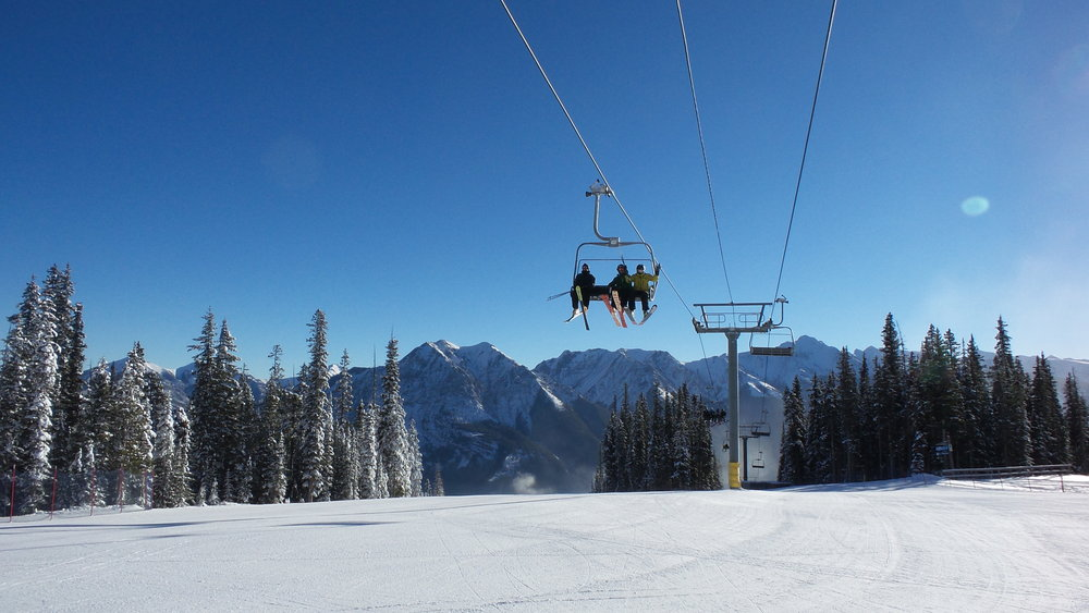 First chair at Nakiska reaches mid-mountain on opening day Nov. 15, 2014 . - © Resorts of the Canadian Rockies