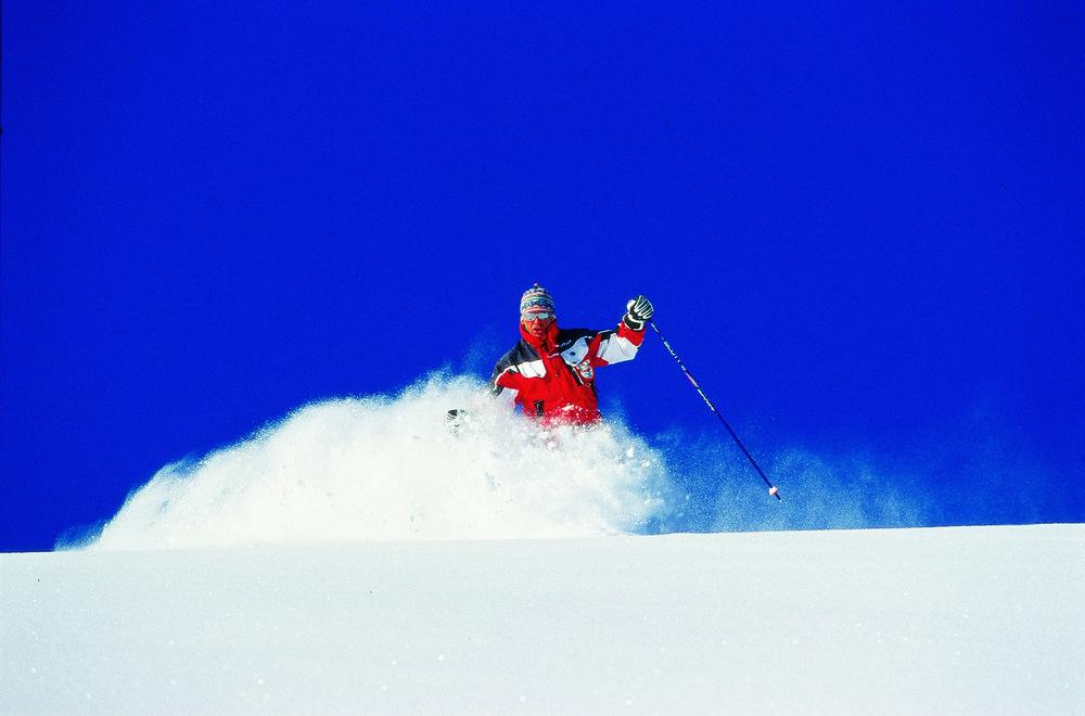 Skier in thick powder at Hochfugen, AUT.