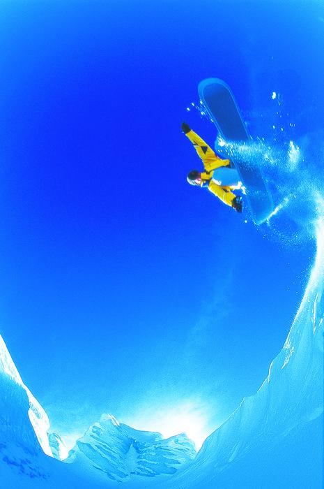 A snowboarder catching air in Hochfuegen AUT