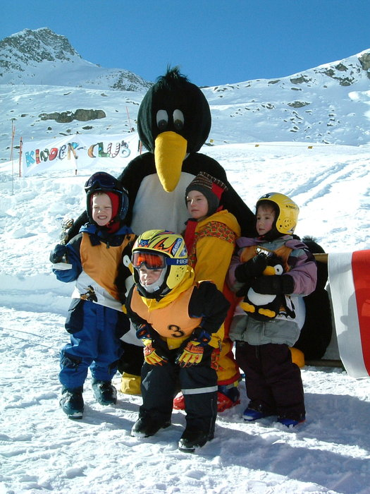 A penguin mascot entertaining children at Mölltaler Glacier AUT