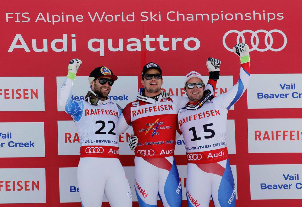 Podium Abfahrt, von links: Travis Ganong (USA), 2. Platz, Patrick Küng (CH), Sieger, Beat Feuz (CH), 3. Platz - ©Audi Media Service