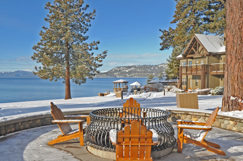 Relax at the fire pits overlooking Lake Tahoe at the Hyatt Regency this winter. - © Hyatt Regency Lake Tahoe