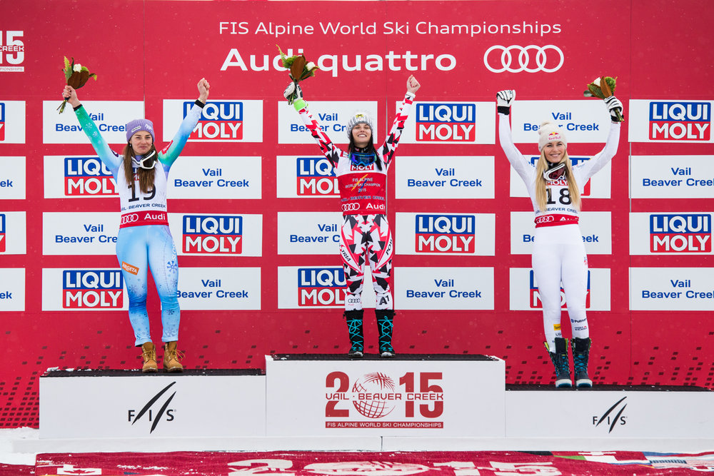 Women's super-G podium. Bronze for Vonn's first race. - © Liam Doran