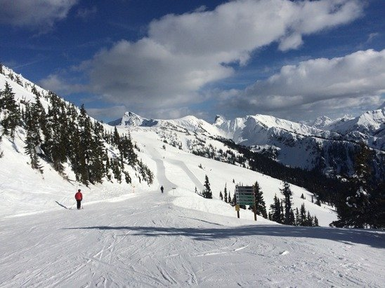 Sunny skies. Groomers good from noon on on the lower mountain, a few thin spots low down. Upper mountain softened up in mid afternoon. For western Canada not too bad for overall base depth. You're skiing in the sun...better than being at work.
