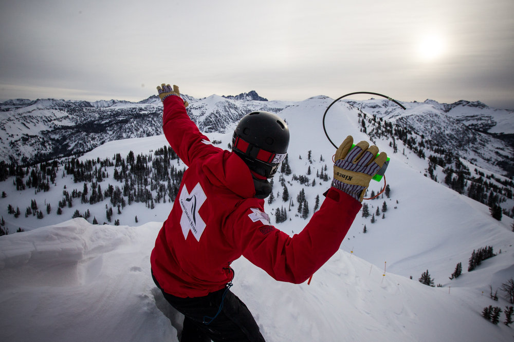 Bombs away! Dave Thibodeau throws a charge off the east side of Peaked Mountain. - © Cody Downard Photography