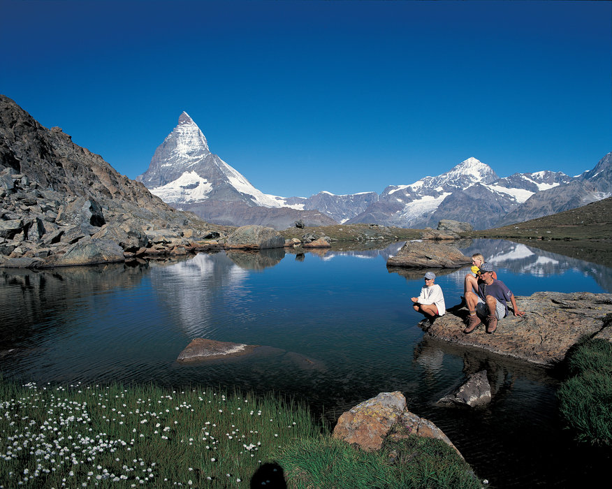 Switzerland. get natural. .Zermatt (1616 m), traffic-free resort  in the Matter valley, Valais. The Riffelsee (2757 m) in the Gornergrat region, backdropped by the Matterhorn (4478 m).. .Schweiz. ganz natuerlich. .Zermatt (1616 m), autofreier Ferienort zuoberst im Mattertal. Der Riffelsee (2757