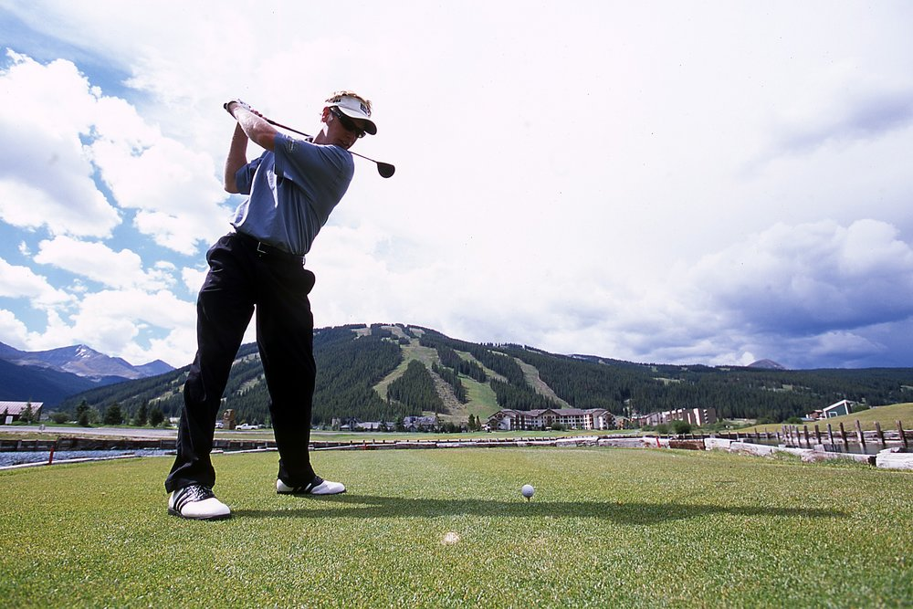 A golfer about to take a cut at Copper Creek, CO.