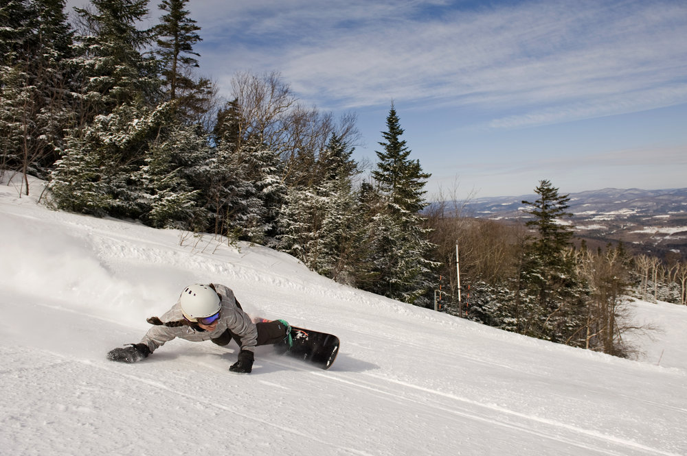 A snowboarder taking a sharp turn at Smugglers' Notch, Vermont.