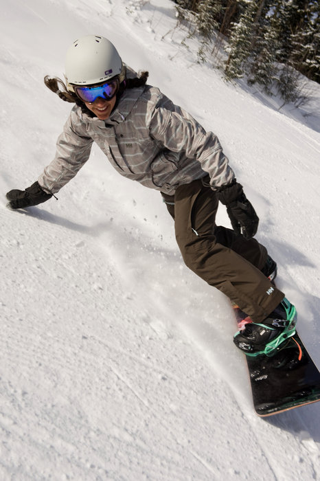 A snowboarder turning down the slopes of Smugglers' Notch, Vermont.