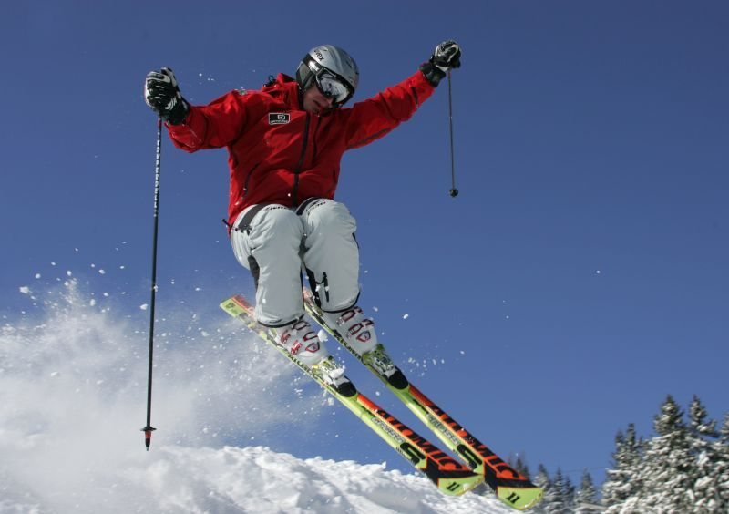 Freeskier jumping and kicking up snow