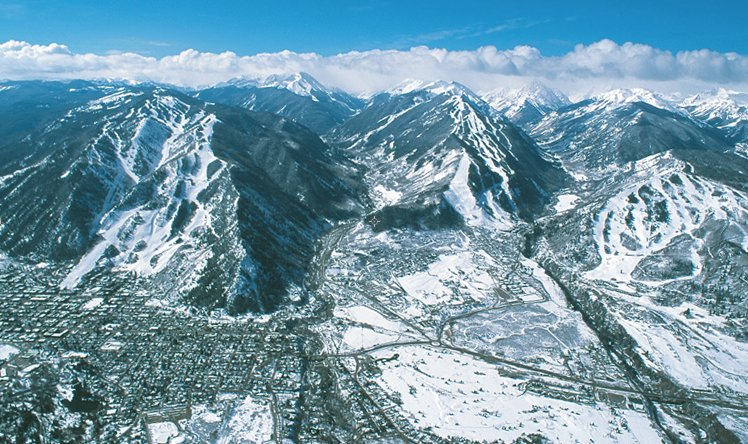 Aerial view of Aspen Mountain, Aspen Highlands and Buttermilk (left to right) - ©David Perry