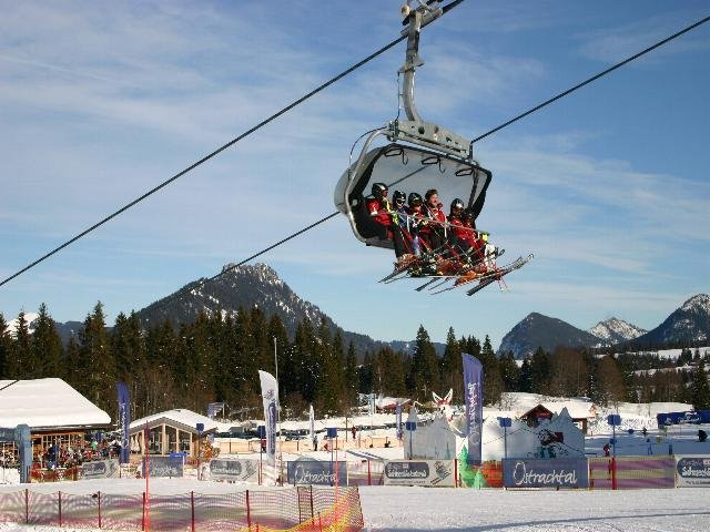 Skiers on lift at Oberjoch, Germany.