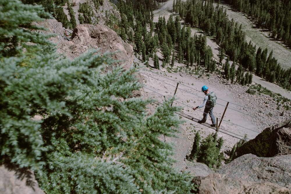 Mammoth's Via Ferrata features a Suspension Bridge that traverses the rock face about 3/4-way up that allows climbers to transfer from the first half of one route to the second half of another. - © Peter Morning (Mammoth Mountain)