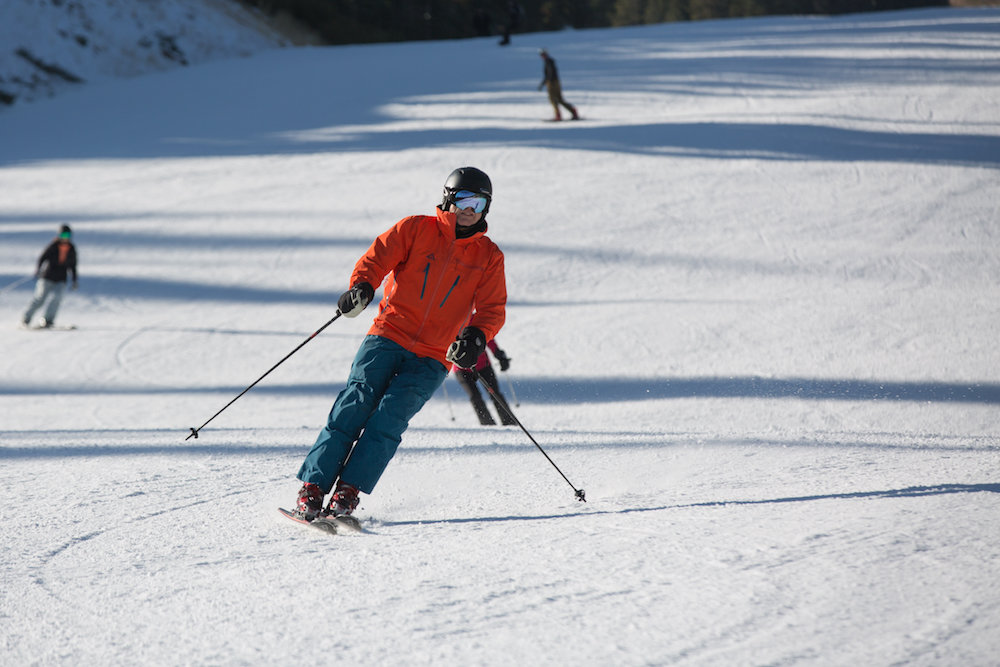 A skier leans into one of the first turns of the season at Northstar. - © Northstar