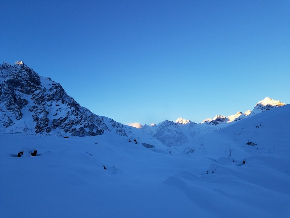The sun crests over the horizon at Ski Portillo. - © Ski Portillo