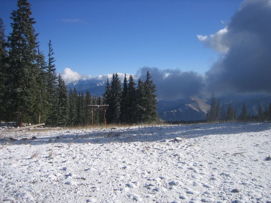 Snow covers the ground and trail signs on the Red Buffalo trail at Beaver Creek Resort in October 2007