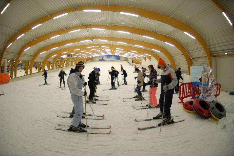 Skiers taking a lesson at Ice Mountain, Belgium.
