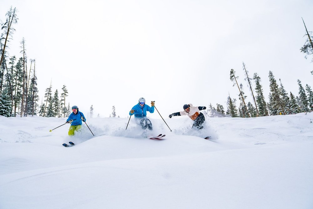 A pack of skiers making short work of the fresh at Wolf Creek this February. - © Carl Frey