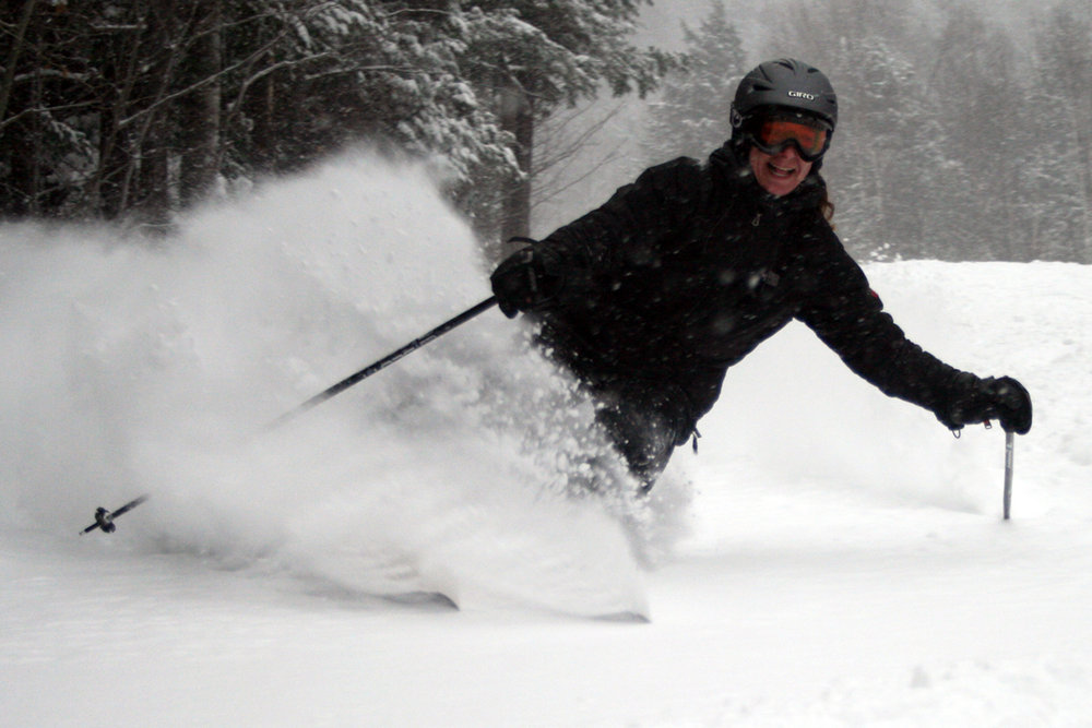 Skier cuts through the powder at King Pine, New Hampshire