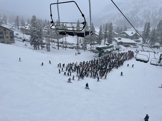 Kirkwood - Friday's 30-minute lift line at chair 6. Saturday is going to be even more crowded. Many people not taking mask wearing seriously. You'll be elbow-to-elbow with exposed noses and exposed mouths.  - © Anonymous