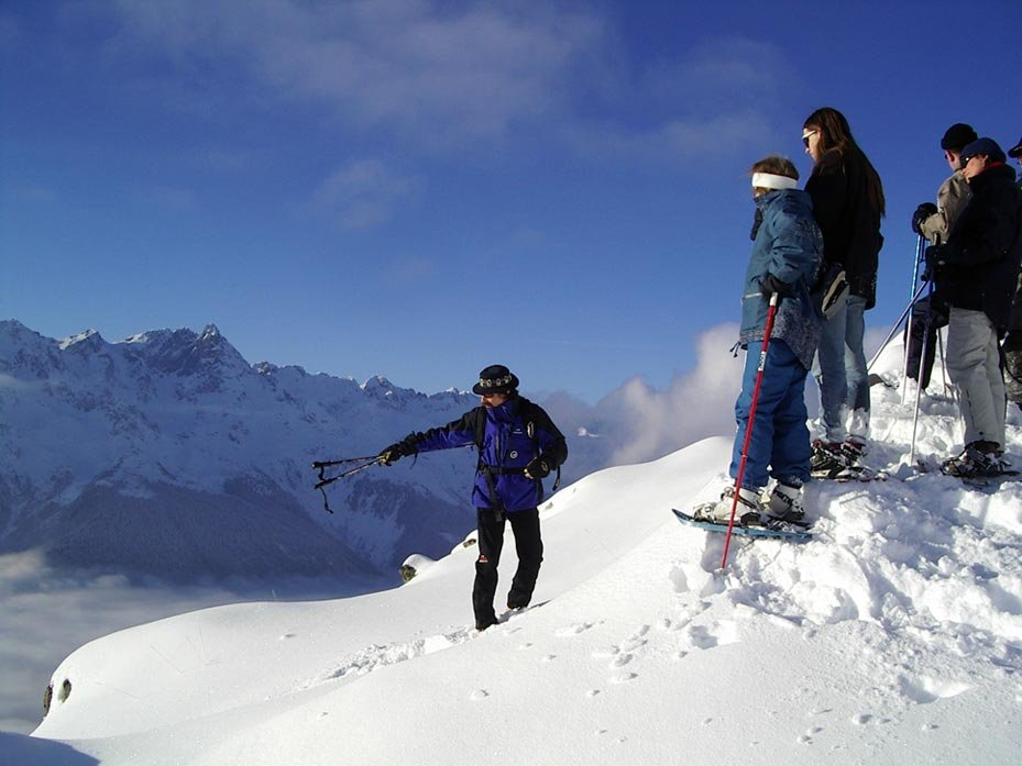 Skiers following a guide in Oz en Oisans, France.